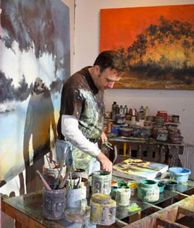 Eric O'Dell painting in his studio